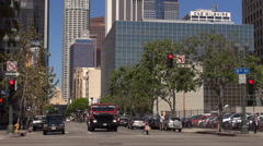 Timelapse heavy traffic street in downtown Los Angeles financial tower building  - stock footage