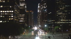 Aerial view Los Angeles night transportation on large boulevard financial area Stock Footage