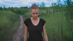 Inspired woman walking at a field Stock Footage