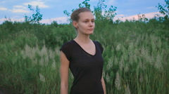 Inspired woman doing yoga at a field Stock Footage