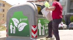 Man Throwing Big In Garbage Container Stock Footage