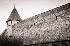 Medieval wall and tower in old Tallinn city - stock photo