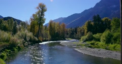 A beautiful nature scene in Bella Coola. A sparking river with forest Stock Footage