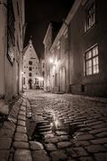 Medieval street in old town at night Stock Photos