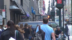 Busy sidewalk in downtown Manhattan people at rush hour bustling street New York Stock Footage