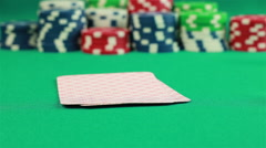 Poker Chips and Two Aces on green background Stock Footage
