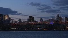 Timelapse nightfall over Queensboro Bridge New York City panorama symbol emblem  Stock Footage