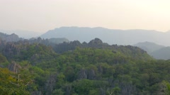 Sunset view landscape mountains and jungle, Laos. Long shot, telephoto lens. Stock Footage