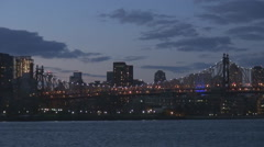 Traffic car on Queensboro Bridge at twilight New York City cityscape American US Stock Footage