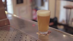 Bartender Serving Draft Beer At Bar - stock footage