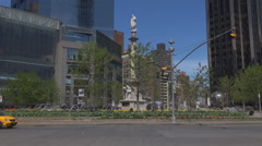 Yellow taxi traffic in Columbus Circle in downtown of New York City vehicle pass Stock Footage