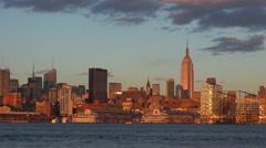 Timelapse orange light over New York City at sunset sunrise enjoy landmark icon Stock Footage