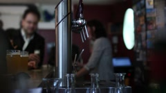 Beer Taps And People Drinking Beer At Bar Counter Stock Footage