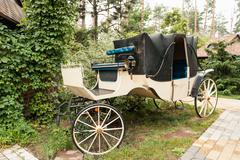 Vintage white coach with gray saloon - stock photo