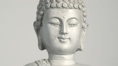 Rotating sitting Buddha statue close up shot against white background (loop) - stock footage
