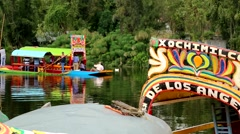 Man paddles the Gondola at the Xochimilco Canals. Stock Footage