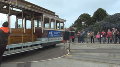 Cable car in boarding station gripman rotate empty wagon turntable San Francisco Stock Footage