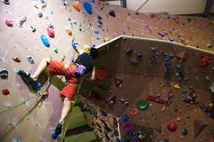 Japanese climbing athlete in action - stock photo