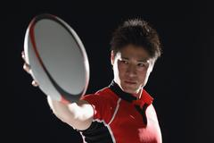 Portrait of Japanese rugby player with ball - stock photo