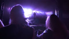 Two girls enjoying night perfomance of musicians Stock Footage