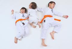 Japanese kids in karate uniform on white background - stock photo