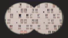 Pov Binoculars Spying On Apartments Stock Footage