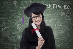 Bachelor with mortarboard and diploma Stock Photos