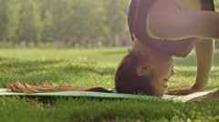 Attractive fitness young woman making yoga poses. Headstand, dolly shot Stock Footage