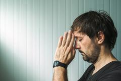 Profile portrait of Christian man praying with copy space Stock Photos