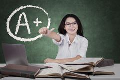 Student with OK sign and grade A plus Stock Photos