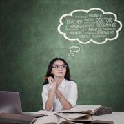 Teenage schoolgirl thinking dream jobs Stock Photos