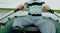 Man on boat. Close up view to the rubber boat paddle. rowing oars. - stock footage