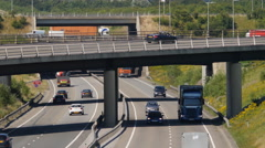 Busy motorway junction on a hot day Stock Footage