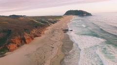 4k aerial view along beach waves sunset big sur Stock Footage