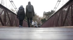 People Crossing Bridge In Buttes Chaumont Park In Paris, Low Angle Stock Footage