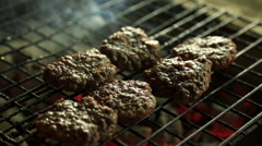 Grill with sizzling meatballs Stock Footage