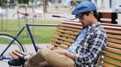 Man drawing to sketchbook with pencil on street 42 Stock Footage