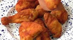 Fresh fried chicken on plate - stock footage