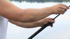 Fisherman pushes the telescopic fishing rod close up Stock Footage
