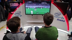 Teenagers playing video games in computer club, soccer tournament Stock Footage