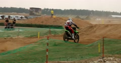 Motocross, rider jumps from a hill Stock Footage