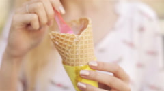 Beautiful Woman Eating Ice Cream on a Summer Day Outdoors Stock Footage