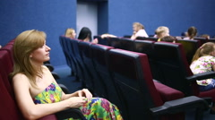 Woman sitting on a presentation in the theater. school holidays. Stock Footage