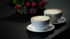 Two cups of coffee on the table, latte art Stock Footage