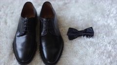 Black shoes and bow tie - stock footage