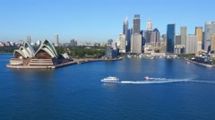 Aerial footage of Ferry in Sydney Harbour Cruising Past Opera House Stock Footage