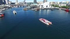 Aerial footage of Ferries entering Darling Harbour, Sydney Stock Footage