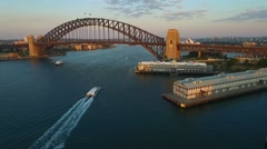 Crane down with Speed Ramp of Aerial footage of Sydney Harbour Bridge Stock Footage