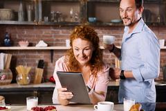 Astonished man and woman looking at tablet Stock Photos