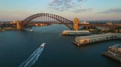 Aerial footage of Ferry and Sydney Harbour Bridge Crane Down Stock Footage